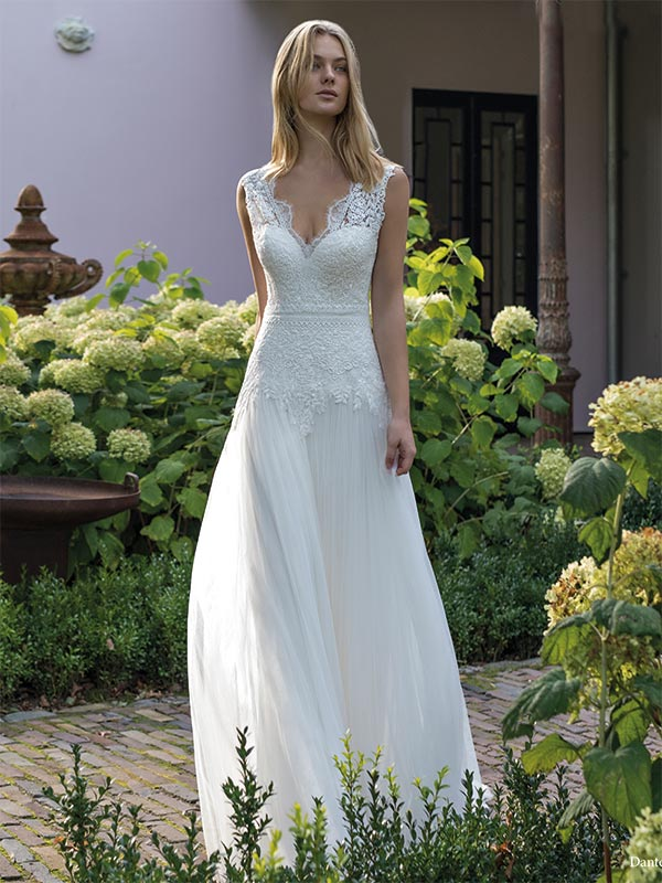 Woman in garden scene wearing a Modeca Bridal dress