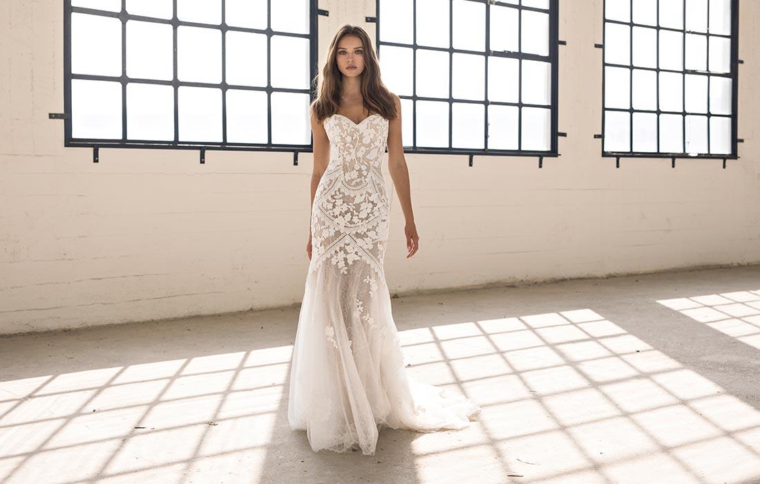 Woman wearing a Papillon By Modeca bridal dress