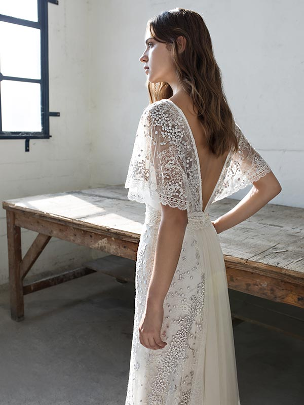 Woman in profile wearing Papillon By Modeca bridal dress