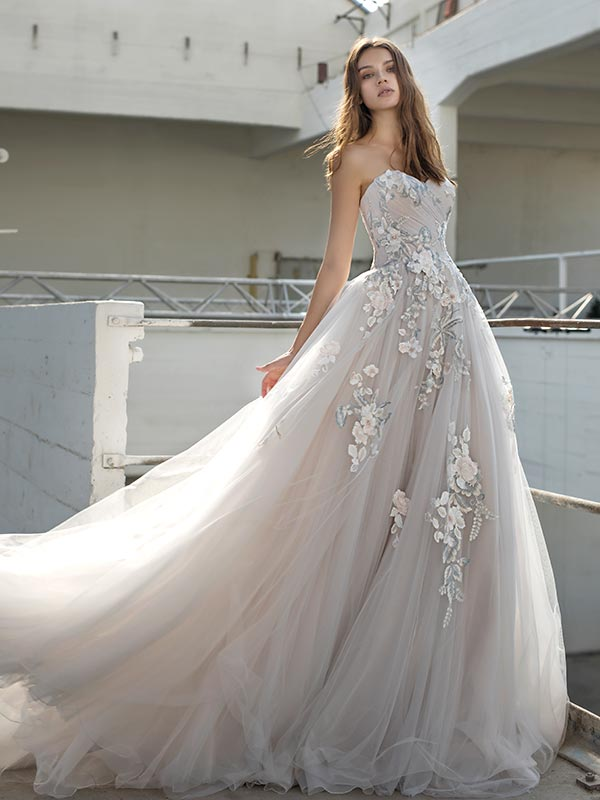 Woman in flowing Papillon By Modeca bridal dress