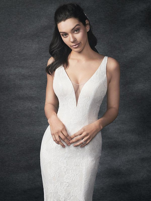 Bride wearing a sleek Gallery wedding dress