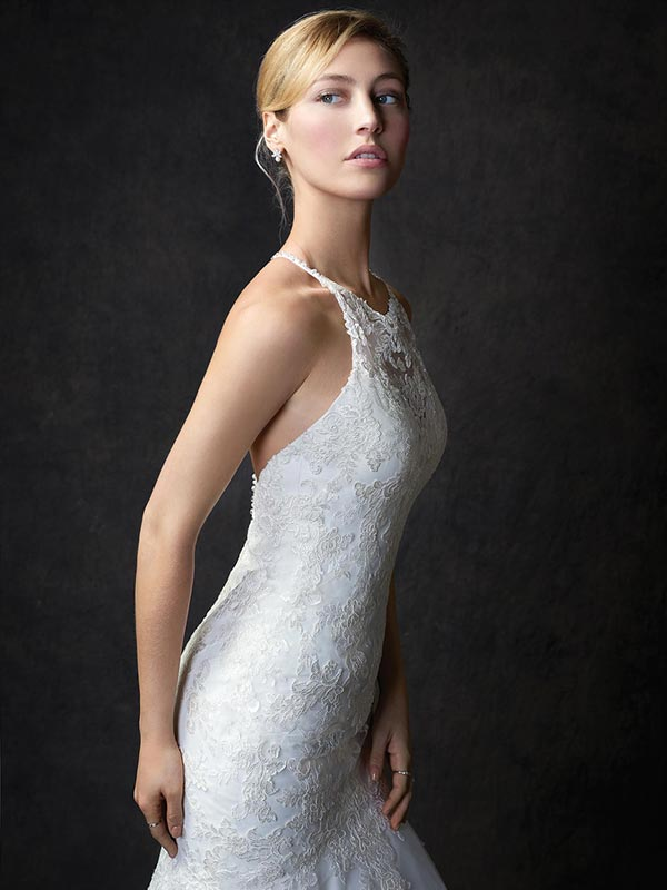 Blonde bride in profile wearing a Gallery wedding dress